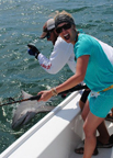 Woman catches a shark