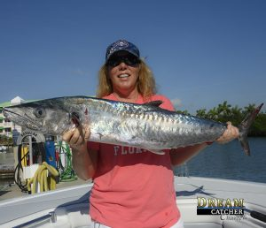 Fishing Key West reef for kingfish. This lady angler holds up a nice kingfish.