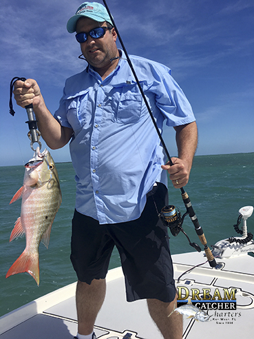 Mutton Snapper and Angler