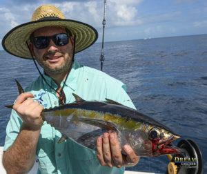 Blackfin tuna held by fishing guy