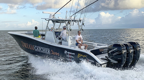 Yellowfin 36 center console reef fishing boat powered by  triple Mercury 400 Verados running.